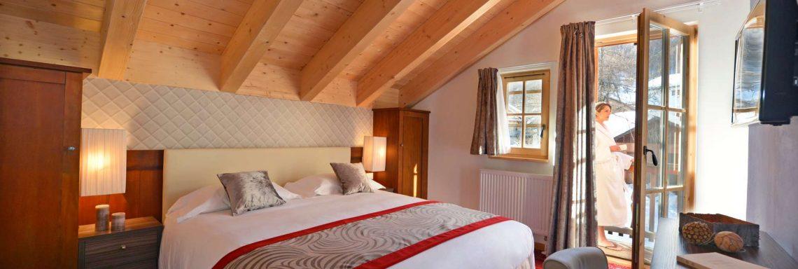 Club Med Pragelato Vialattea, en Italie - Chambre avec plafond cathédrale en bois