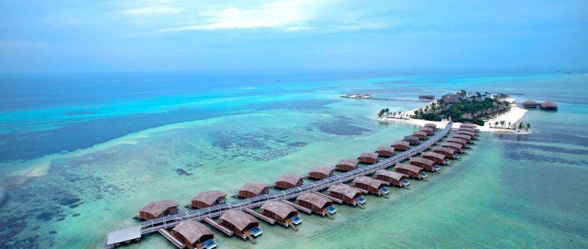 Club Med Villas de Finolhu, aux Maldives - vue aérienne des villas sur pilotis