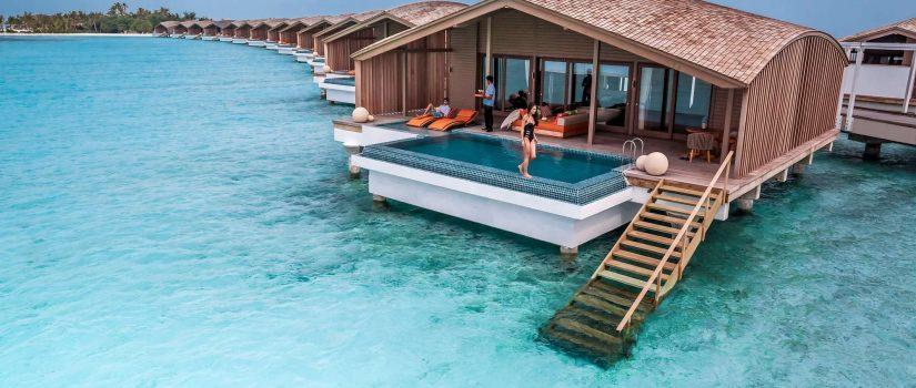 Club Med Villas de Finolhu, aux Maldives - Image des villas sur pilotis, en rangée unes après les autres.
