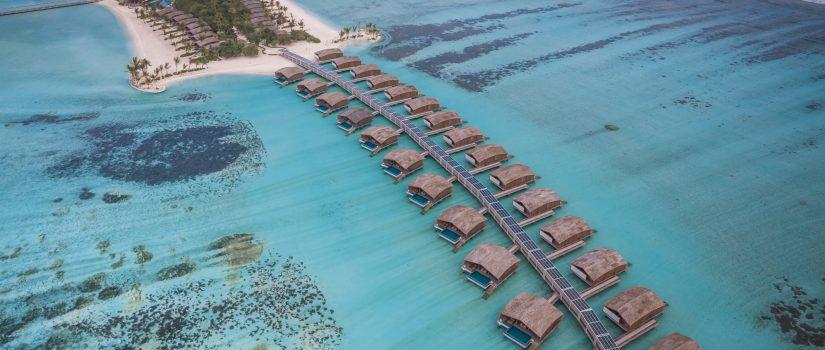 Club Med Kani, aux Maldives - Vue aérienne des villas sur pilotis surplombant l'Océan