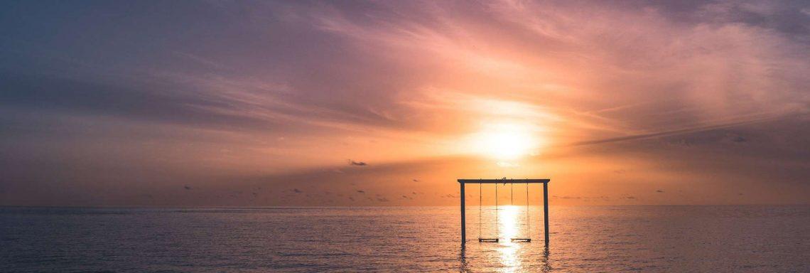 Club Med Villas de FInolhu, aux Maldives - Image d'un coucher de soleil sur la mer au Club Med Les Villas de Finolhu